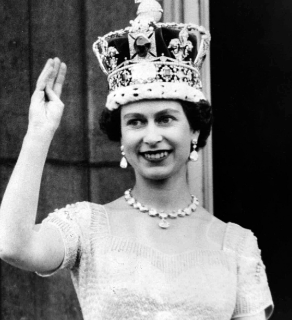 How was Queen Elizabeth II brought up?